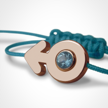 SEX SYMBOL BOY blue topaz bracelet in 750 pink gold and blue cord by the jewellery collection for children MIKADO.